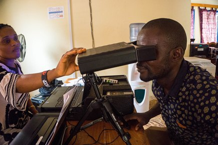 The biometric traits of the participant, including an iris scan, are captured to verify the identity of the participant when visiting the clinic.