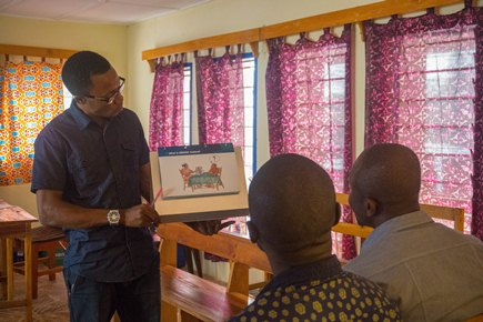 The flipchart contains drawings made by a Sierra Leonean artist, and is used to support the consenting process.
