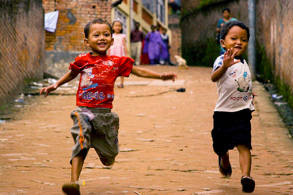 two young boys running
